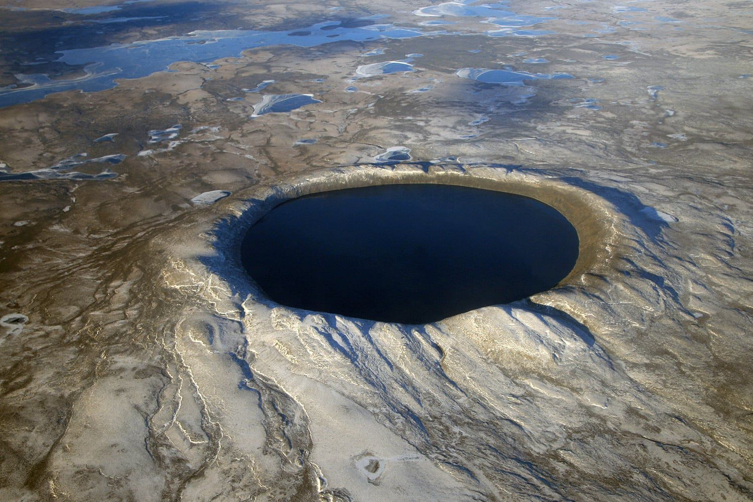 The Pingualuit crater is an impact crater located in the territory of Nunavik, Quebec, Canada. It contains a basin called lake Pingualuk.